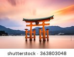Stock photo miyajima hiroshima japan at the floating gate of itsukushima shrine gate sign reads itsukushima 363803048