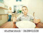 teenage boy waiting for dinner... | Shutterstock . vector #363841028