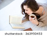cute lovely young woman reading ... | Shutterstock . vector #363950453