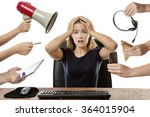 Small photo of overwhelmed business woman sitting at her desk surrounded by many hands holding different objects
