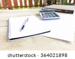 pen  calculator and notebook on ... | Shutterstock . vector #364021898