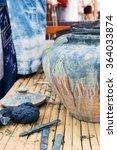 Small photo of Natural indigo dyeing in earthen jar; folk wisdom of Thailand