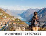 Young girl looking at the panoramic scenery at Monte Bre, Lugano, Switzerland