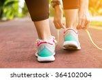 fitness woman tying running... | Shutterstock . vector #364102004