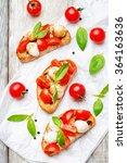 caprese bruschetta on a white...   Shutterstock . vector #364163636