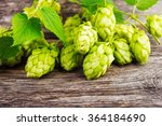 green hop cones on a wooden... | Shutterstock . vector #364184690