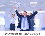 Business Team Celebrating A...