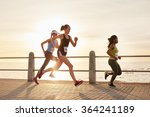 three young women running on a... | Shutterstock . vector #364241189
