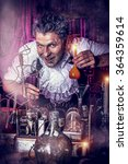 Small photo of Crazy old man medieval scientist working in his laboratory. Alchemist. Halloween.