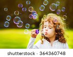 Little Girl Blowing Soap...