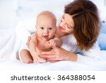 mother and child on a white bed.... | Shutterstock . vector #364388054