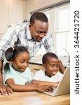 happy family using laptop in... | Shutterstock . vector #364421720
