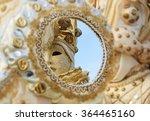 Reflection Of Venetian Mask In...