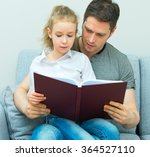 father reading book with... | Shutterstock . vector #364527110