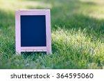 chalk board on grass field ... | Shutterstock . vector #364595060