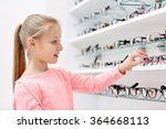 Little Girl Choosing Glasses At ...