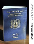 Small photo of the cover of the passport of the Syrian Arab Republic closeup