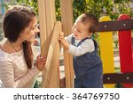 young mother playing with her... | Shutterstock . vector #364769750