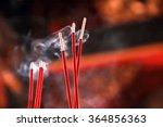 Burning Red Incense Sticks In...
