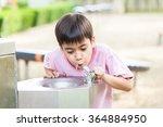 little boy drinking water in... | Shutterstock . vector #364884950