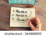 Small photo of Retro effect and toned image of a woman hand writing a note with a fountain pen on a notebook. Handwritten text PRACTICE, business success concept