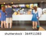 Blurred people order fast food...