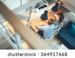 Small photo of Beautiful couple talking in their pristine home while sitting at kitchen counter