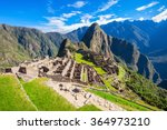 View of the Lost Incan City of Machu Picchu near Cusco, Peru. Machu Picchu is a Peruvian Historical Sanctuary and a UNESCO World Heritage Site. Machu Picchu is  located in the Cusco Region in Peru.