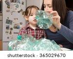 little girl collecting plastic... | Shutterstock . vector #365029670