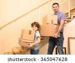 family moving into a new house | Shutterstock . vector #365047628