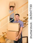 family moving into a new house | Shutterstock . vector #365047730