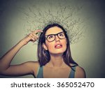 Small photo of Closeup portrait young woman scratching head, thinking daydreaming with brain melting into lines question marks looking up isolated on gray background. Human facial expressions, emotion feeling sign