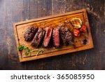 sliced steak ribeye with... | Shutterstock . vector #365085950