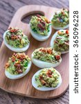 bacon guacamole deviled eggs | Shutterstock . vector #365096228