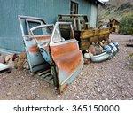Rusty Car Doors Leaning Against ...