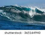 A Surfer Wipes Out On A Huge...