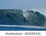 A Surfer Rides A Huge Wave At...