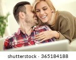 couple sitting on sofa with... | Shutterstock . vector #365184188