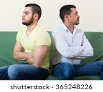 two male adults sitting on... | Shutterstock . vector #365248226