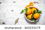 Fresh Oranges With Leaves In A...