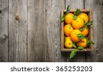 Oranges With Leaves In An Old...