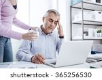 tired businessman in the office ... | Shutterstock . vector #365256530