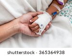 mother holding child's hand who ... | Shutterstock . vector #365364938