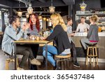 young friends conversing while... | Shutterstock . vector #365437484