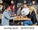 young waiter serving drinks to... | Shutterstock . vector #365437604