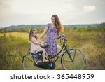 mother with the child and bike | Shutterstock . vector #365448959