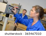 lady altering controls on... | Shutterstock . vector #365467010