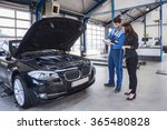 car mechanic and customer stand ... | Shutterstock . vector #365480828