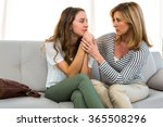 mother comforting her daughter... | Shutterstock . vector #365508296