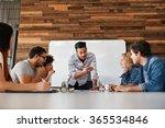 brainstorming in a boardroom of ...   Shutterstock . vector #365534846